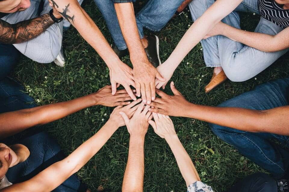 Support group joining hands, Castle Craig drug and alcohol rehab