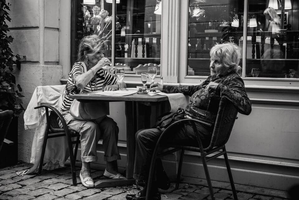 Two women drinking during the day; is alcoholism hereditary, Castle Craig rehab