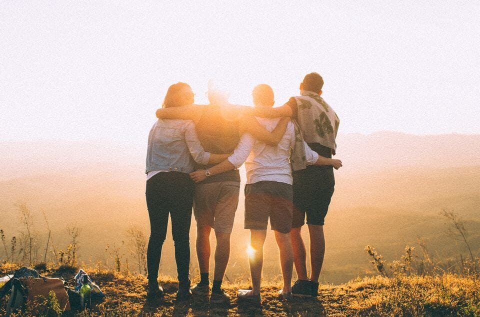 Friends hug on mountain; making healthy relationships in recovery, Castle Craig