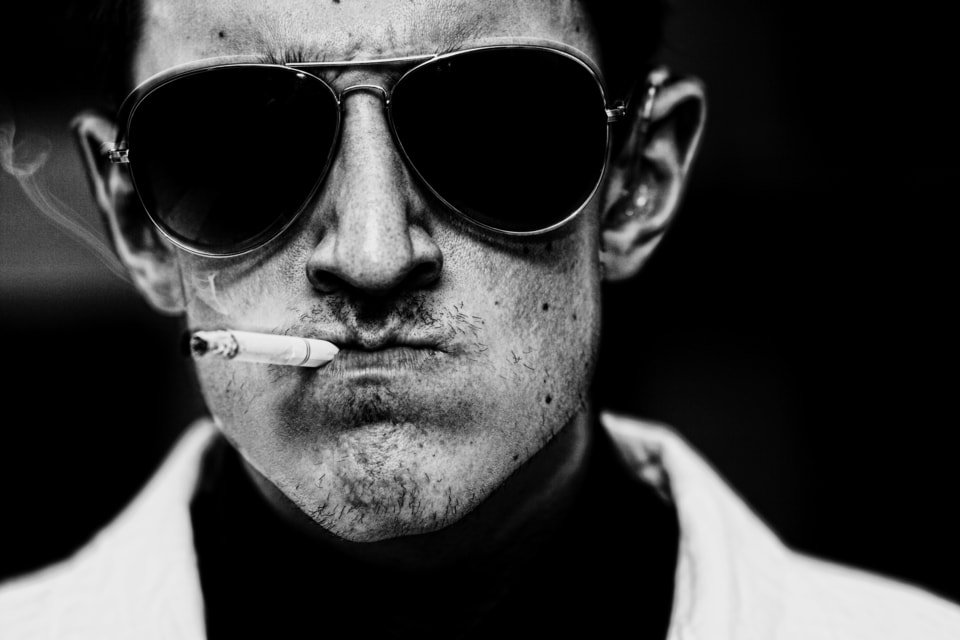 tense man wearing sunglasses smokes, what are the most addictive drugs, Castle Craig rehab