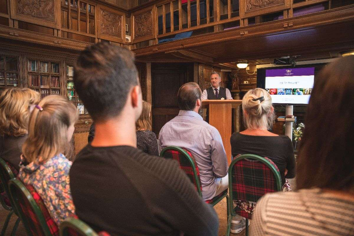 A room full of Castle Craig clients enjoying a presentation